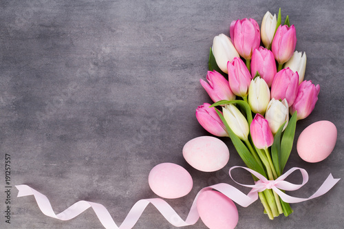 Mother's Day, woman's day, easter, pink tulips, presents on gray background.