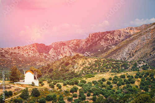 Fotobehang Lichtroze Mountain landscape with small church on Crete Island, Greece