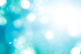 Fototapety Vintage cool cyan blue green color blurred sky background with nature glowing sun light flare and bokeh