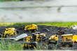 Yellow Toy Trucks in Coal pit