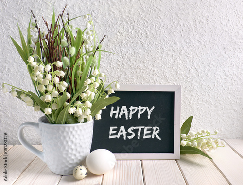 Fotobehang Lelietjes van dalen Blackboard decorated with lily of the valley flowers and Easter eggs, text