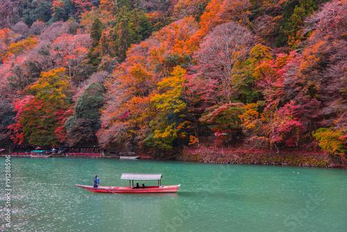 Keuken foto achterwand Kyoto Boatman punting the boat at Katsura River.