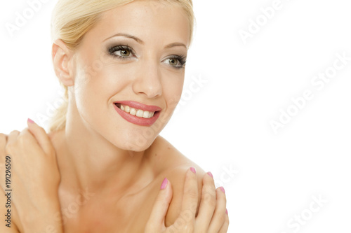 Senasual portrait of young smiling blonde on white background