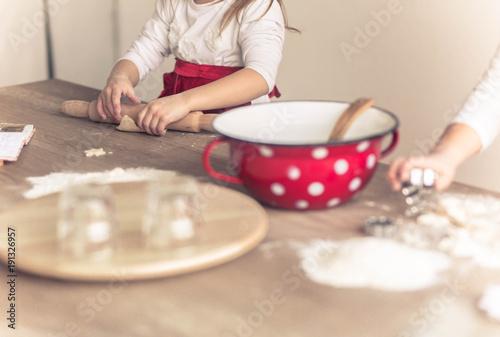 Happy children bake cookies