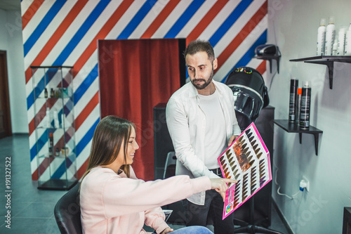 Fotobehang Kapsalon Image of a young client choosing hair color in the hair salon