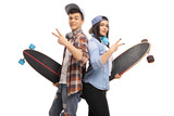Teenage hipsters with longboards making peace signs