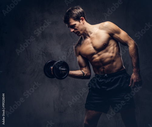 Studio portrait of a shirtless athletic tattooed male