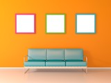 Nice waiting room with with blue sofa three picture frames on yellow wall - 191333757