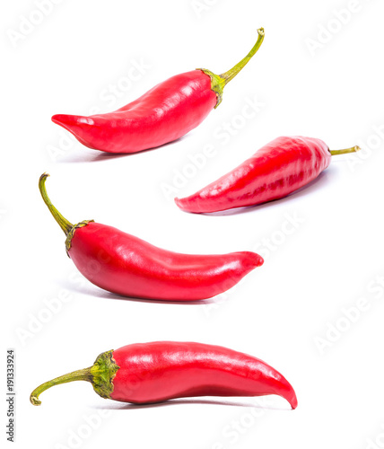 Fotobehang Hot chili peppers Set of four isolated on white red hot peppers. Acute spice for food. Healthy food. Bright colors.