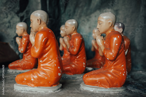 Fotobehang Boeddha Buddhist monk statue in lotus position.