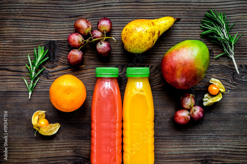 Keuken foto achterwand Sap fitness smoothie in plastic bottle on wooden table top view mock