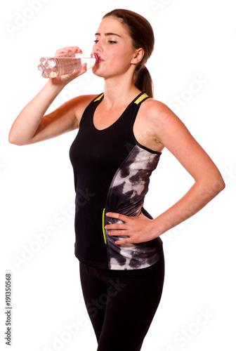 Plexiglas Fitness Junge Sportlerin trinkt Wasser