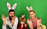 Family members preparing for Easter on green background
