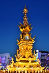 Golden Clock Tower in Chiang Rai, Thailand after sunset