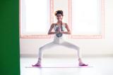 young woman practice yoga indoor full body shot - 191360904