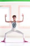 young woman practice yoga indoor full body shot - 191360925