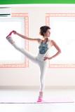 young woman practice yoga indoor full body shot - 191360927