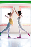 pregnant young woman on yoga class with instructor - 191360957