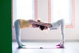 pregnant young woman on yoga class indoor with instructor assisting - 191360959
