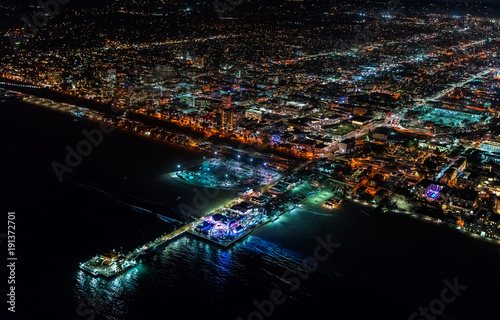 Aerial view of the Santa Monica shoreline, amusment park and pier at night