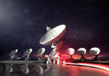 a group of radio telescopes at night glowing under the moonlight. Astronomy background. 3D illustration.
