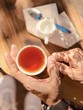 holding cup of tea - 191378753