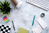 Creative mess on student's desk. Keyboard, notebook, stationery, coffee cup, plant on grey background top view copy space - 191383333