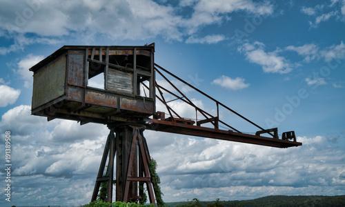 Foto op Canvas Oude verlaten gebouwen Rustic abandoned crane