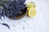 Dry lavender,lemon and honey on the white  wooden background - 191390914