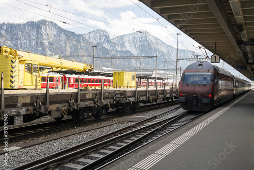 Train station and trains in the alps switzerland