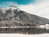 Winterlicher Berggipfel in Tirol mit Bergsee #2 - 191393385