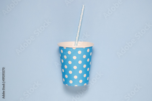 Plain Blue Paper Cup With Drinking Straw On Polka Wallpaper