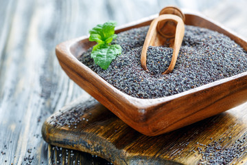 Poppy seeds in a wooden bowl.