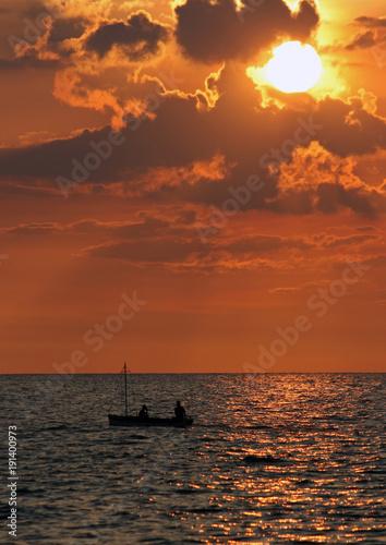 The sun slowly sets over Cuba's coast