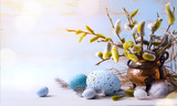 Happy Easter;  Easter eggs and sprig flowers on blue table background - 191407971