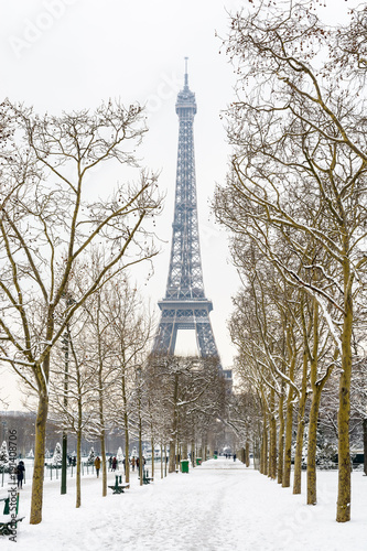 The Eiffel tower by a rare snowy day in Paris seen from the Champ de Mars Poster