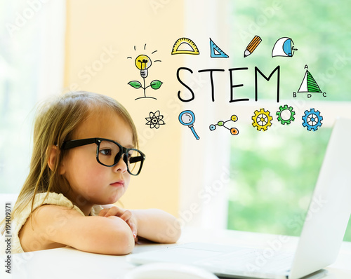 STEM text with little girl using her laptop