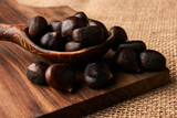 Roasted chestnuts in a wooden spoon - 191410728