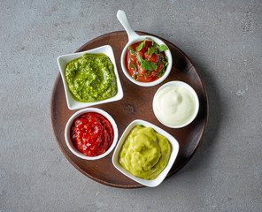 various sauces on grey table