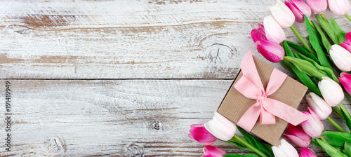 springtime pink tulips on white rustic wooden boards