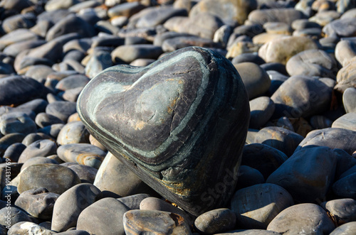 Fotobehang Zen Stenen Heart-shaped sea stone on rock beach,Koh hin ngam , Lipe island, Thailand