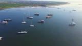 Aerial footage serangan bay with many sailboat anchored - 191432591