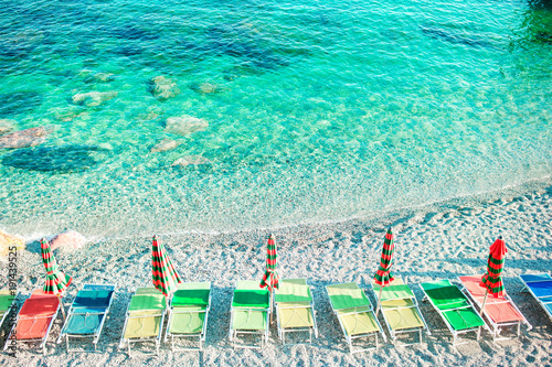 Tuinposter Groene koraal Sunbeds and umbrellas at beautiful european seashore in Monterosso, Cinque Terre, Italy