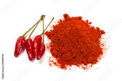 Fotobehang Hot chili peppers Red chili pepper with chili powder