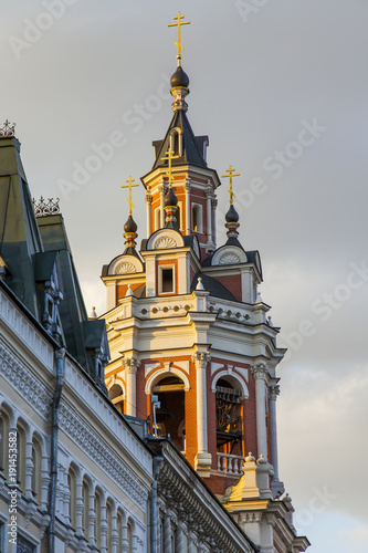 Tuinposter Moskou MOSCOW, RUSSIA, on August 10, 2017. The sun lights the old bell tower on Nikolskaya Street, one of historical streets in the downtown