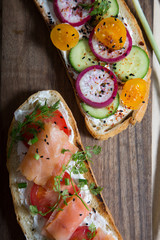 Healthy and tasty toast bread with tomato, radish, salmon fish and cheese on it.