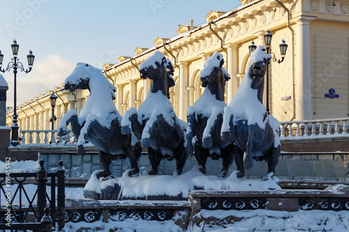 Sculptural group The four seasons Geyser fountain on Manezhnaya square. Winter in Moscow