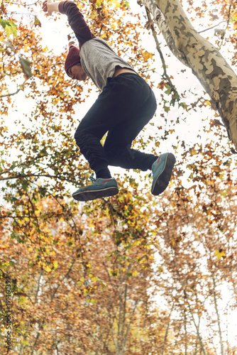 Man jumping from tree in park