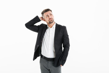 Portrait of man in office wearing jacket looking aside and touching his head, isolated over white background © Drobot Dean