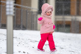 Adorable girl in winter jacket running on the snow - 191468524